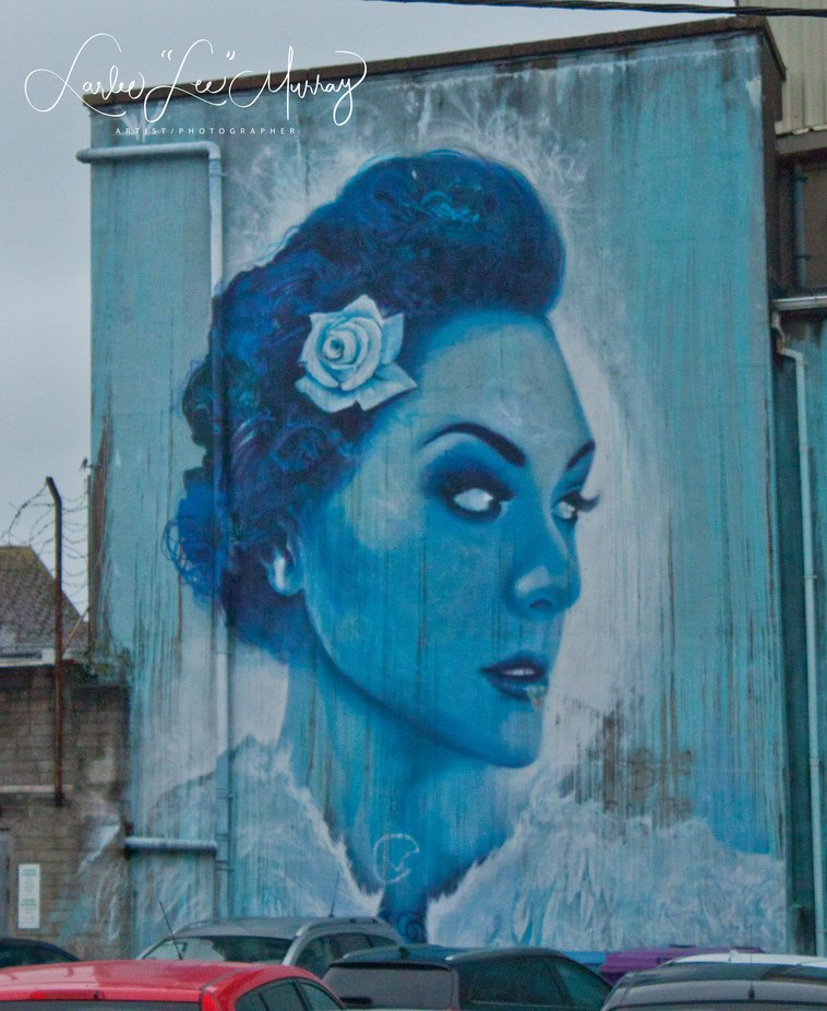 """When parking to go to a street fair I found this amazing painting on the side of the building facing the parking lot - truly """"The Blue Lady"""""""