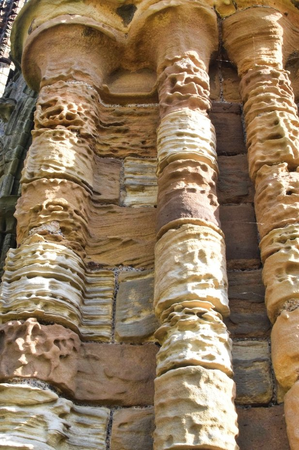 Stone erosion at Whitby Abbey caused by the wind and weather.