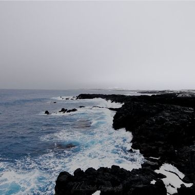The southwest coast of Iceland, more precisely in Reykjanesviti ,. Taken on the way to the Gunnuhver Lagoon. The weather was very tiring, I was much more on the lens cleaning from the rain than when taking pictures. Despite the bad weather, the landscape is breathtaking, as so often in Iceland. The lava rocks with the winter mixture and the sea are overwhelming.