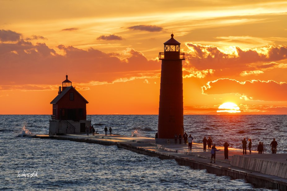 Enjoying an early fall Lake Michigan sunset in Grand Haven, Michigan.