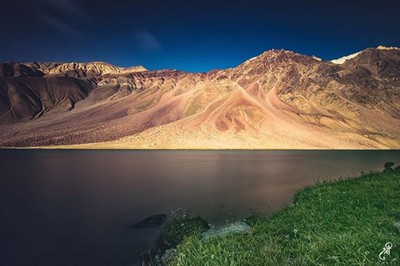 Colors of purity... The Lake of the moon also known as Chandratal lake in Spiti, Himachal Pradesh, India. The beautiful play of colors is due to the mountain textures, sun, cloud and water.  Chandra Taal lake is situated on the Samudra Tapu plateau, which