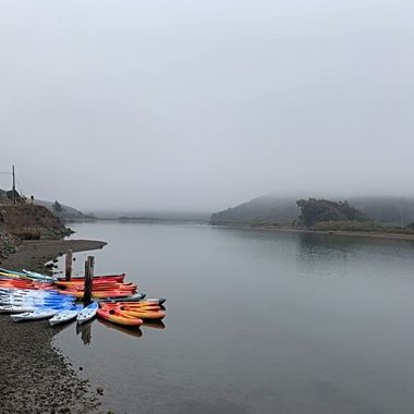 A foggy morning drive along Highway 1 in beautiful Sonoma  , CA.  The colorful kayaks seemed a sharp contrast against the foggy backgrpund.