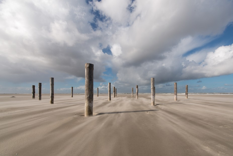 Due to the northwester, sand is blowing over the beach and moving the clouds through the sky. The...