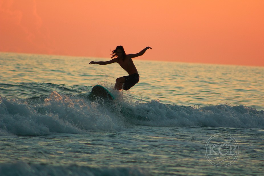 Surfing at sun set