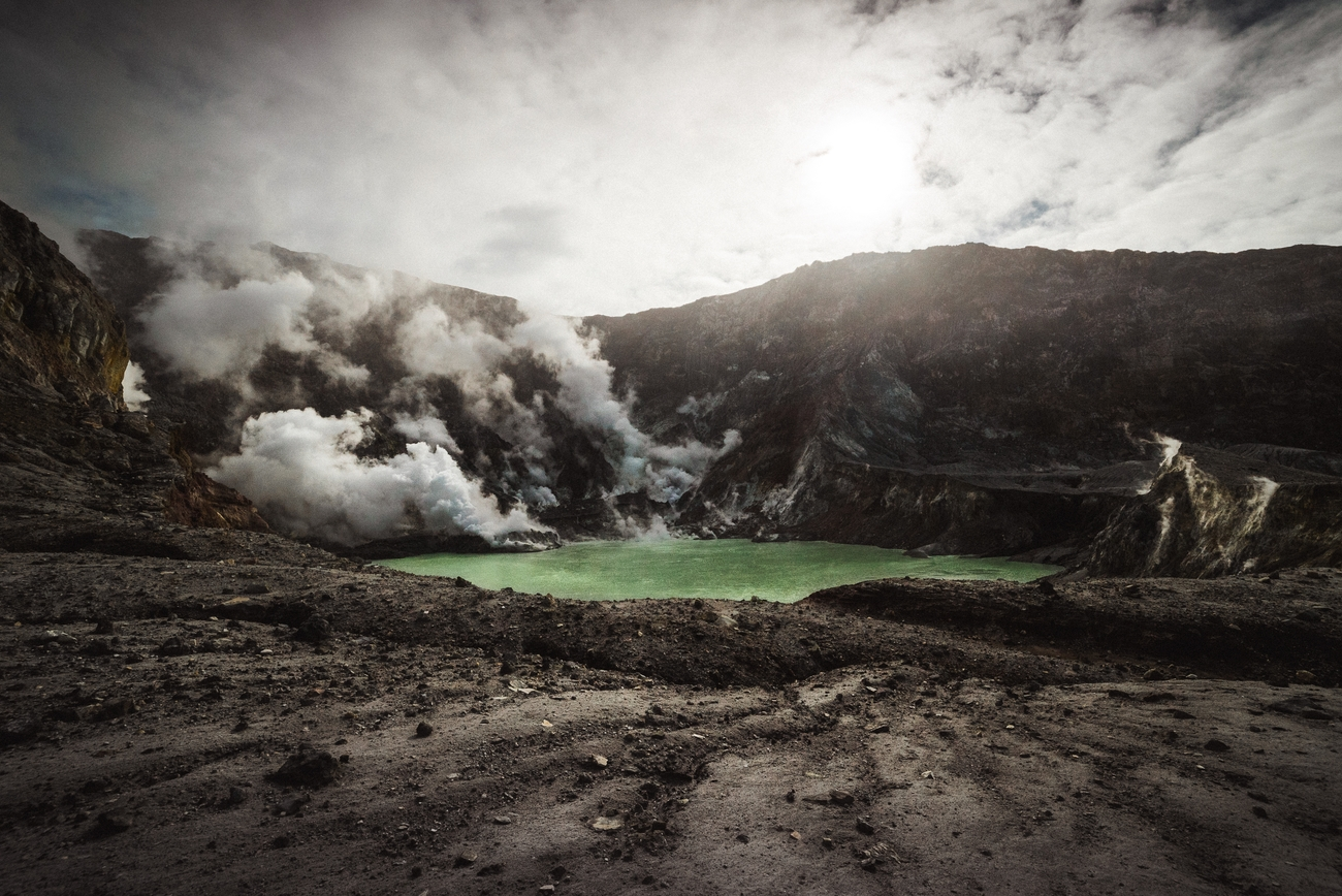 The green lake in the boiling center of White island's crater.