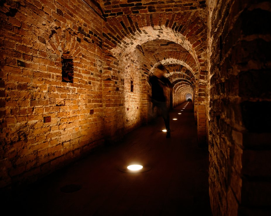 Potterna, Peter&Paul's fortress, St Petersburg. A boy ran and jumped, when he wa...