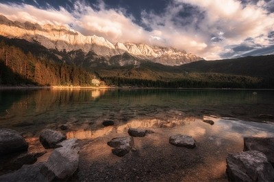 Lake Eibsee located in Southern Bavaria near the Germany - Austria border. The Zugspitze, Germany's highest peak, is seen rising above the landscape.