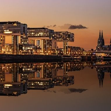 Colorfull sunset over Cologne with reflection