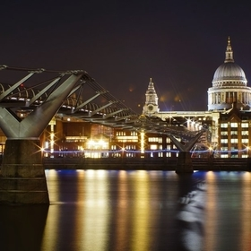 London's Millennium bridge on the river Thames with Saint Paul's Cathedral in the background