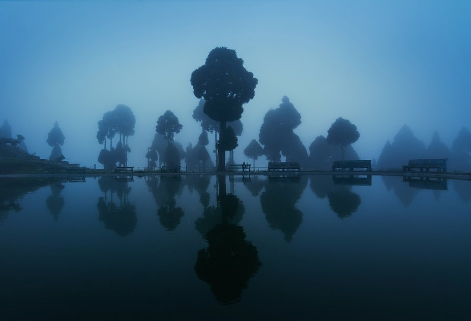 The shot was taken in the blue hour when the fog covered the lake and its surrounding.