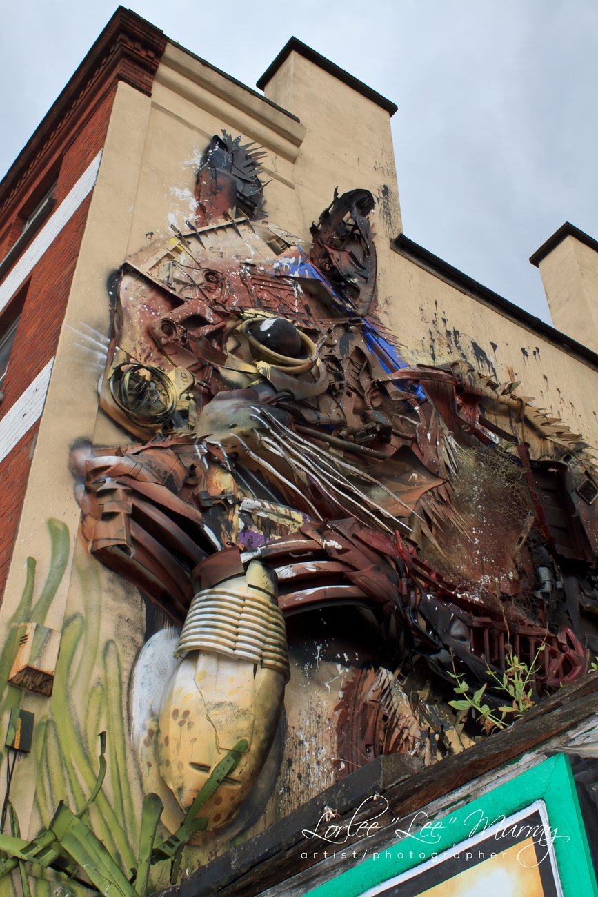 amazing work of recycled parts and paint on wall in Dublin Ireland up close to show the detail of the work and amazing from afar as well.