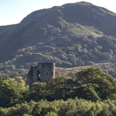 Late afternoon sun outlining Dolbadarn Castle and the mountain behind