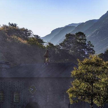 Morning mist on the mountains accompanied by the smoke of the Llanberis Lake steam locomotive.