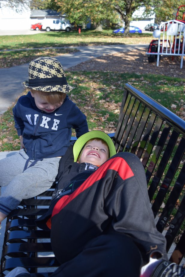 my grandsons sharing a moment at the park