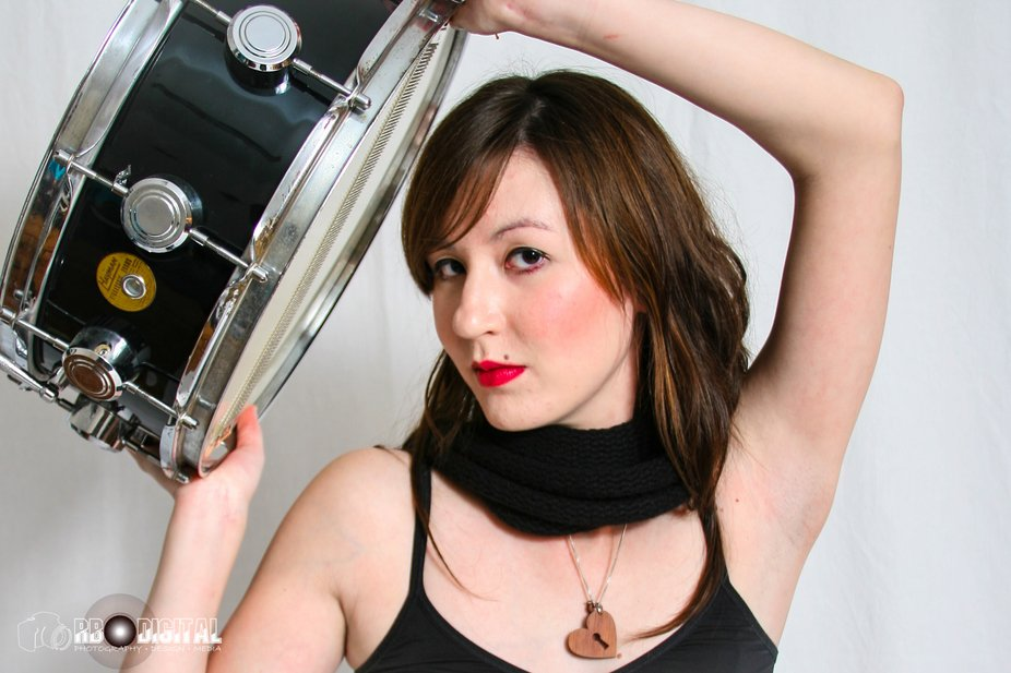 Indy Rock Chick holding snare drum.
