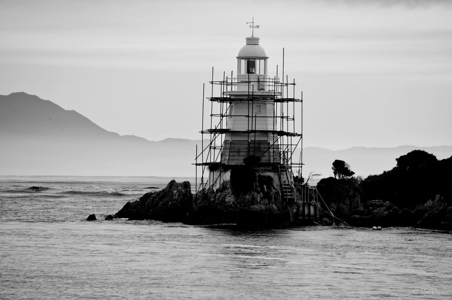 The lighthouse at Hells Gates, the entrance to MacQuarie Harbour on the west coast of Tasmania, A...