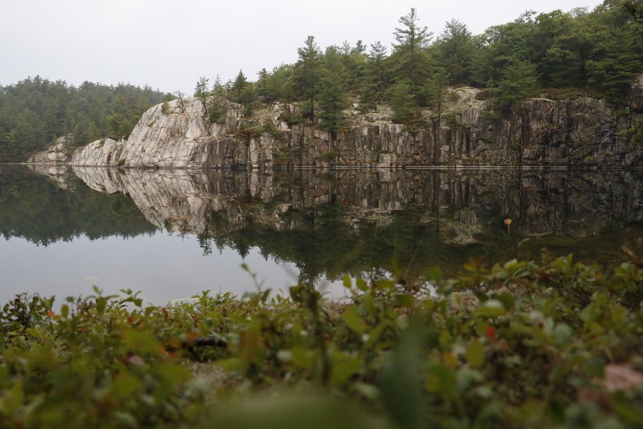 While on a camping trip I woke up early to calm water and a perfect reflection of this cliff.