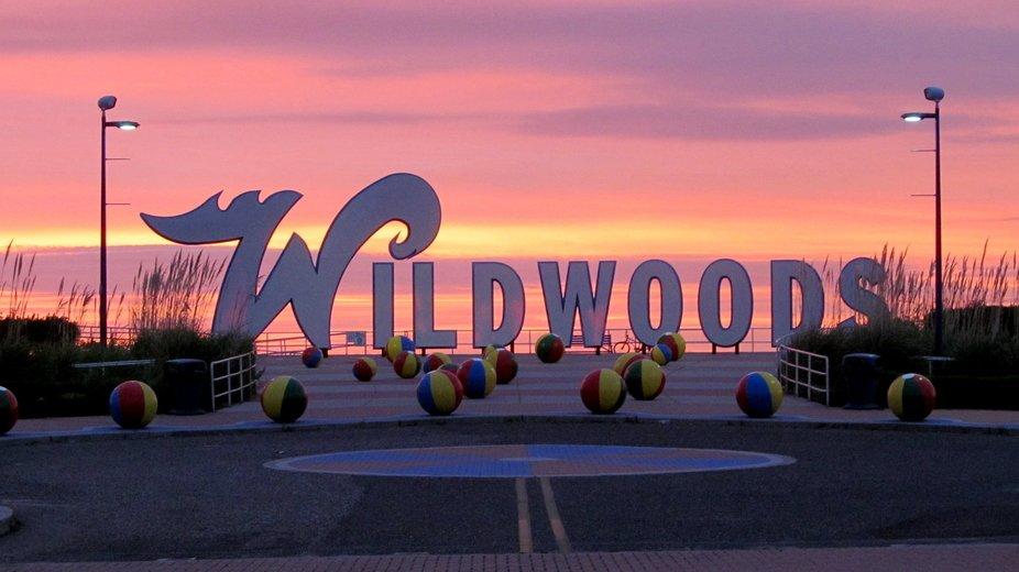 Sunrise on the beach behind the wildwood sign 6:30am.