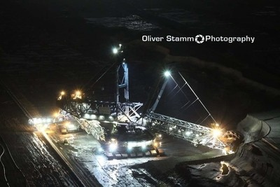 Brown Coal Mining Excavator in open cast Garzweiler near Cologne at night.