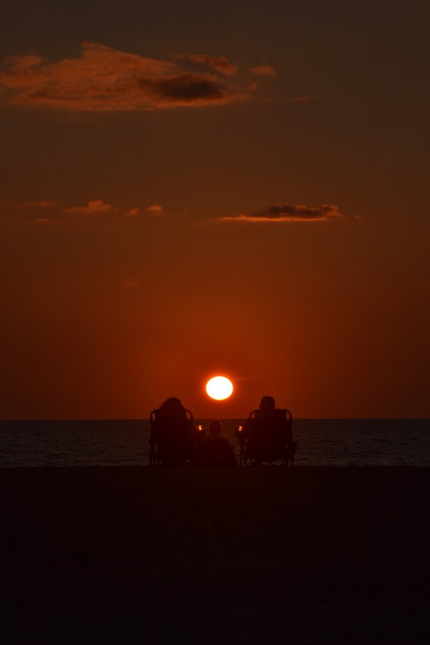 A couple share a sunset made for two on Nokomis Beach in south Florida