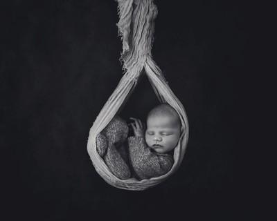 Newborn in Sling