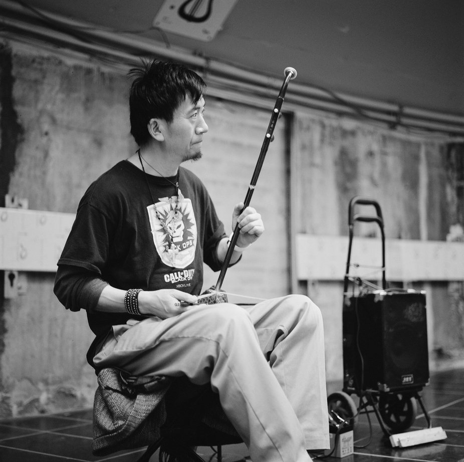 A musical performet at the Montreal metro.   Hasselblad 500C, Zeiss * Planar 80mm F2.8