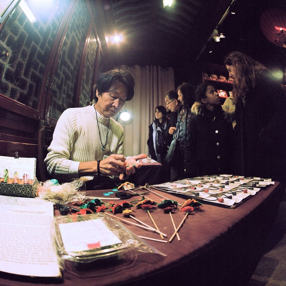 A demonstration of crafts at the Chinese gardens within the Botanical Garden of Montreal, Canada  Kiev 88, MC Arsat 30mm, Kodak Portra 400