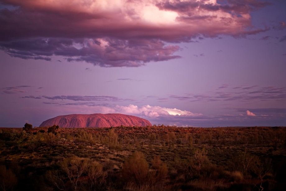 It's rare to see rain in the middle of Australia at Uluru, but on this night there were ...