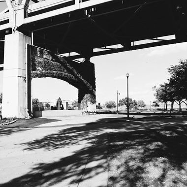 black and white under a bridge