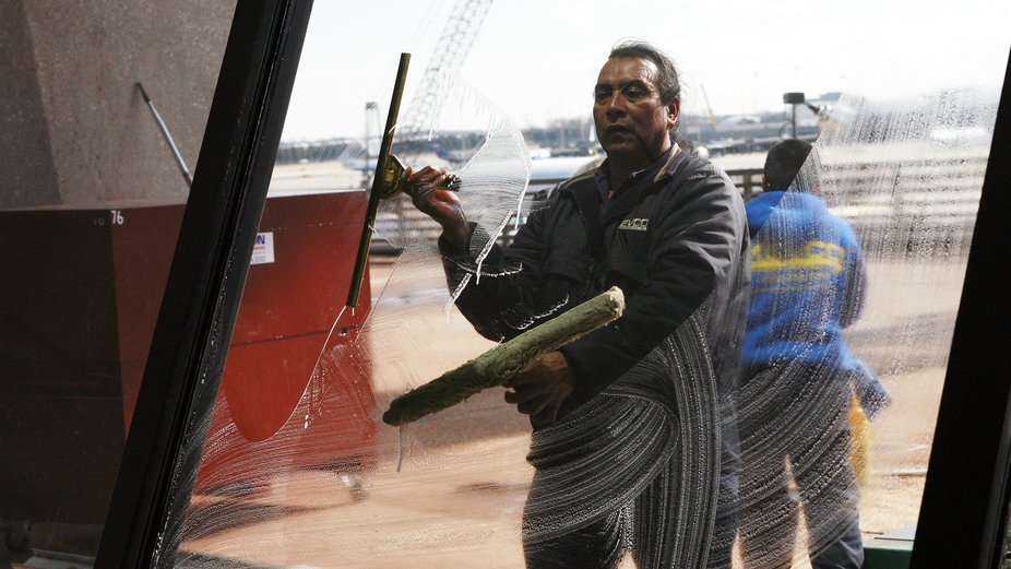 It is not so easy to wash windows the way this man did the day I took this photo. He was aware of...