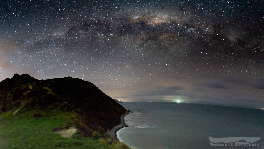 Sitting on top of the cliffs of Makara beach to watch the Milky Way set before it ducks behind th...