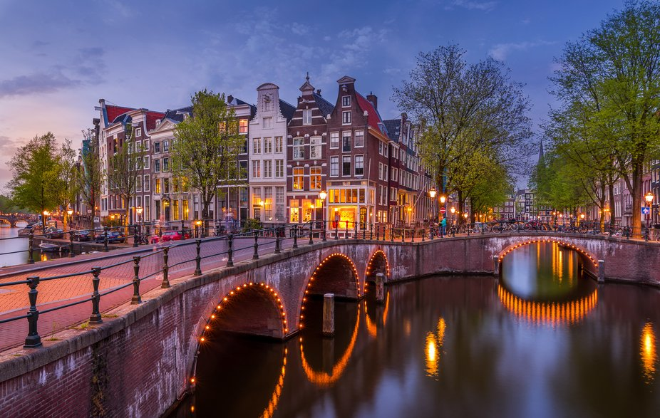 Amsterdam by night is so romantic! The intimacy of the old centre with its lovely canals and stre...