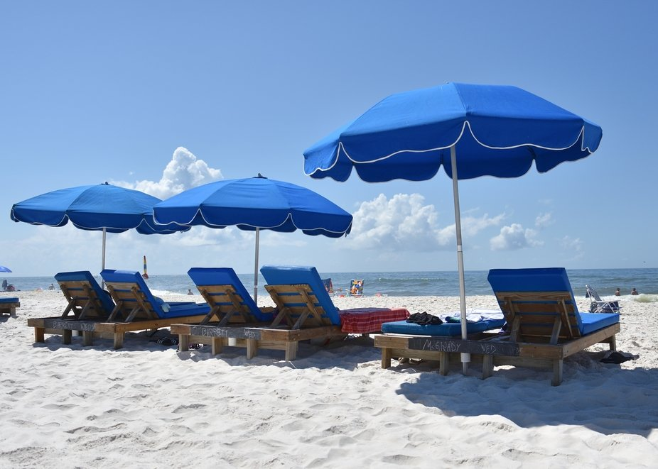 On the beach at Gulf Shores, Alabama.  Vacationing with friends with all renting beach chairs and...