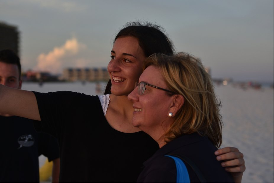 Mother/daughter selfie on the beach.