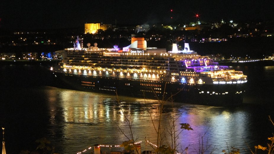 Queen Mary leaving Quebec City at night St Lawrence river