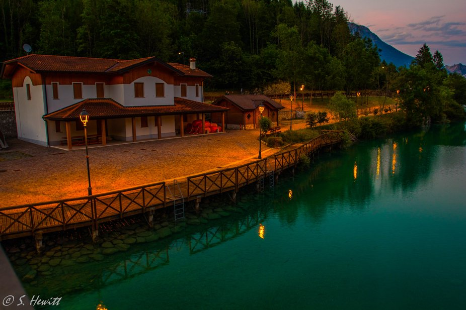 A boathouse on the banks of Barcis Lake in the Italian Dolomites