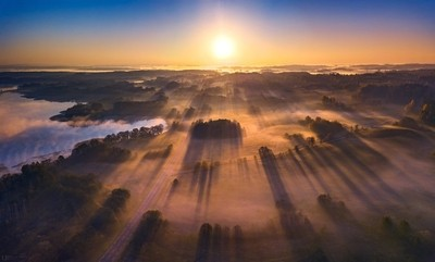Aerial view of epic light rays over the fields