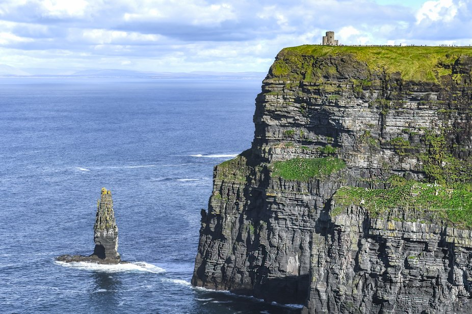 The Cliffs of Moher are located in Burren on the Wild Atlantic Way, a winding coastal road notori...