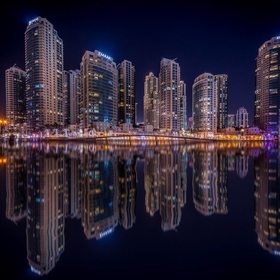 I had a vacation in Dubai and shot this image of a great skyline. I found a place close to the lake and took the time to create this final result...