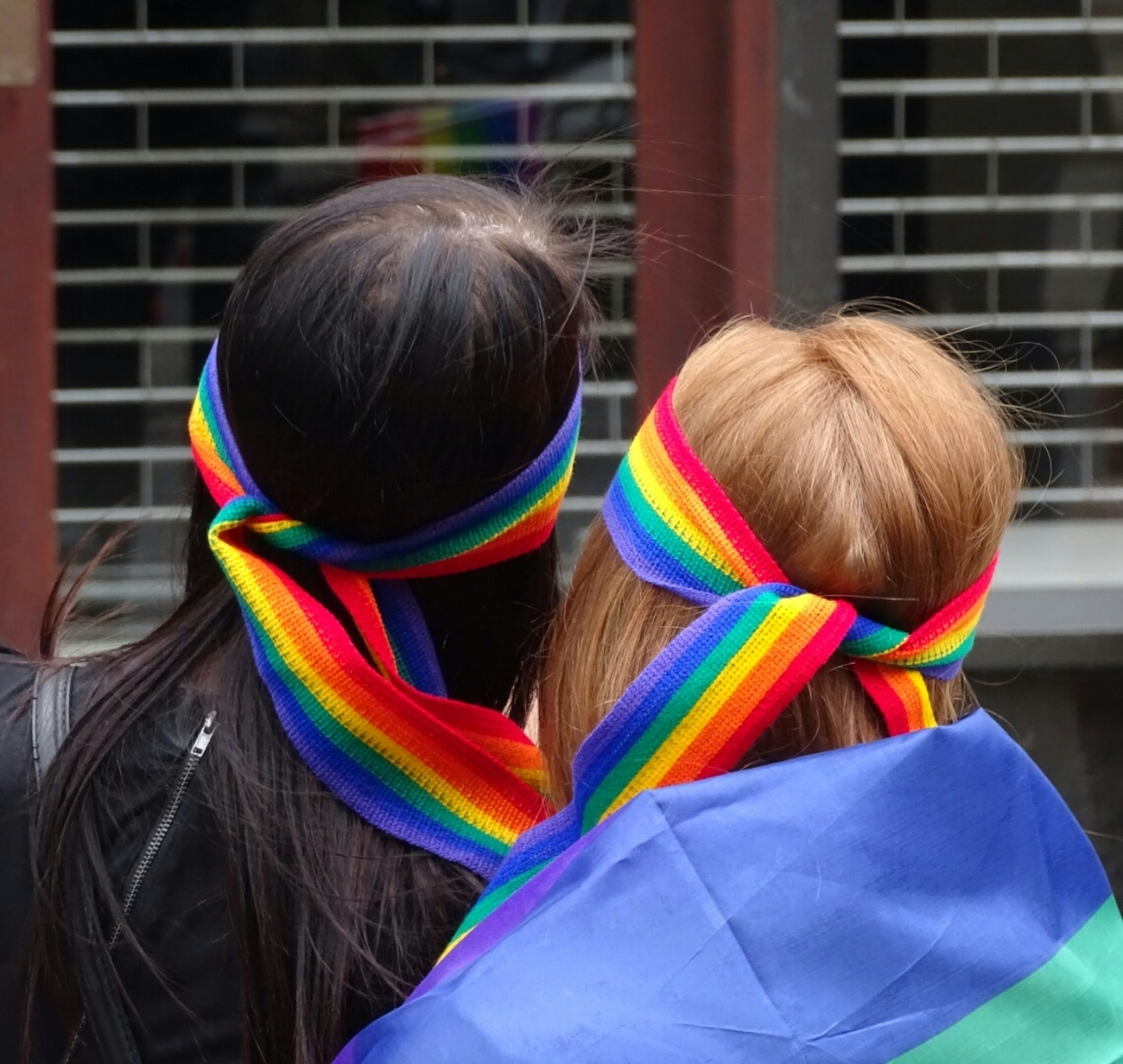 Couple wearing rainbow bandanas at Leeds Pride march