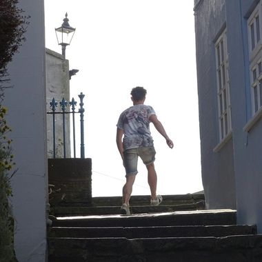 Silhouetted person walking up steps in Staithes, North Yorkshire