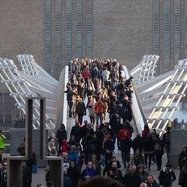 People crossing Millennium bridge, London