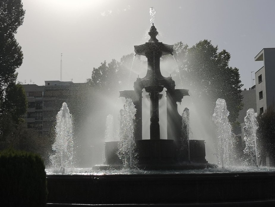 Silhouette of the Fountain de las batallas, Granada, Spain