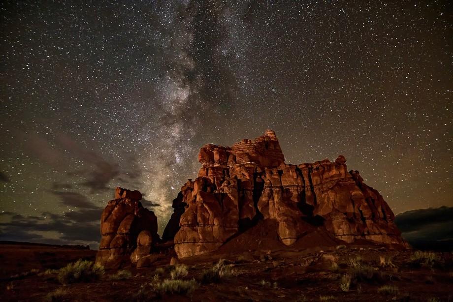 Milky Way over entrada sandstone formation near Goblin Valley, Utah.