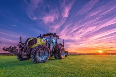 The tractor at sunset