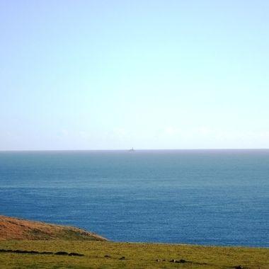Fastnet Lighthouse seen from Mizen Head, 9 miles away.