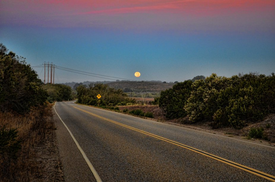 Photographed the setting full moon near Vandenberg AFB, California in November 2013.