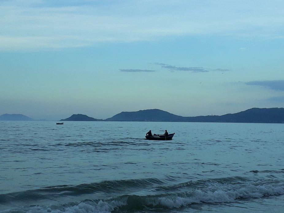 Fishing boat returning to shore at dawn
