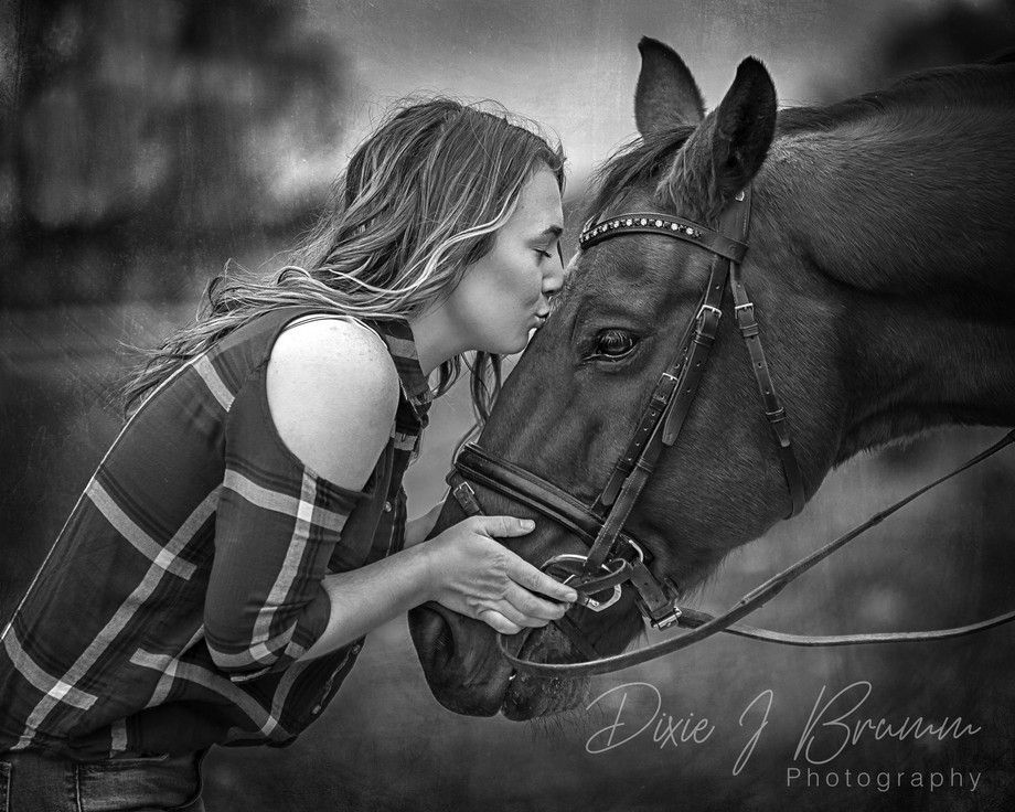 A beautiful girl and her horse during a senior portrait session