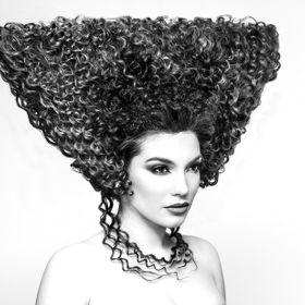 A bnw beauty concept shot, featuring a wonderful original hairstyle, for a contemporary hairstyling competition.  Hairstyle: Anca Gogance Model: ...